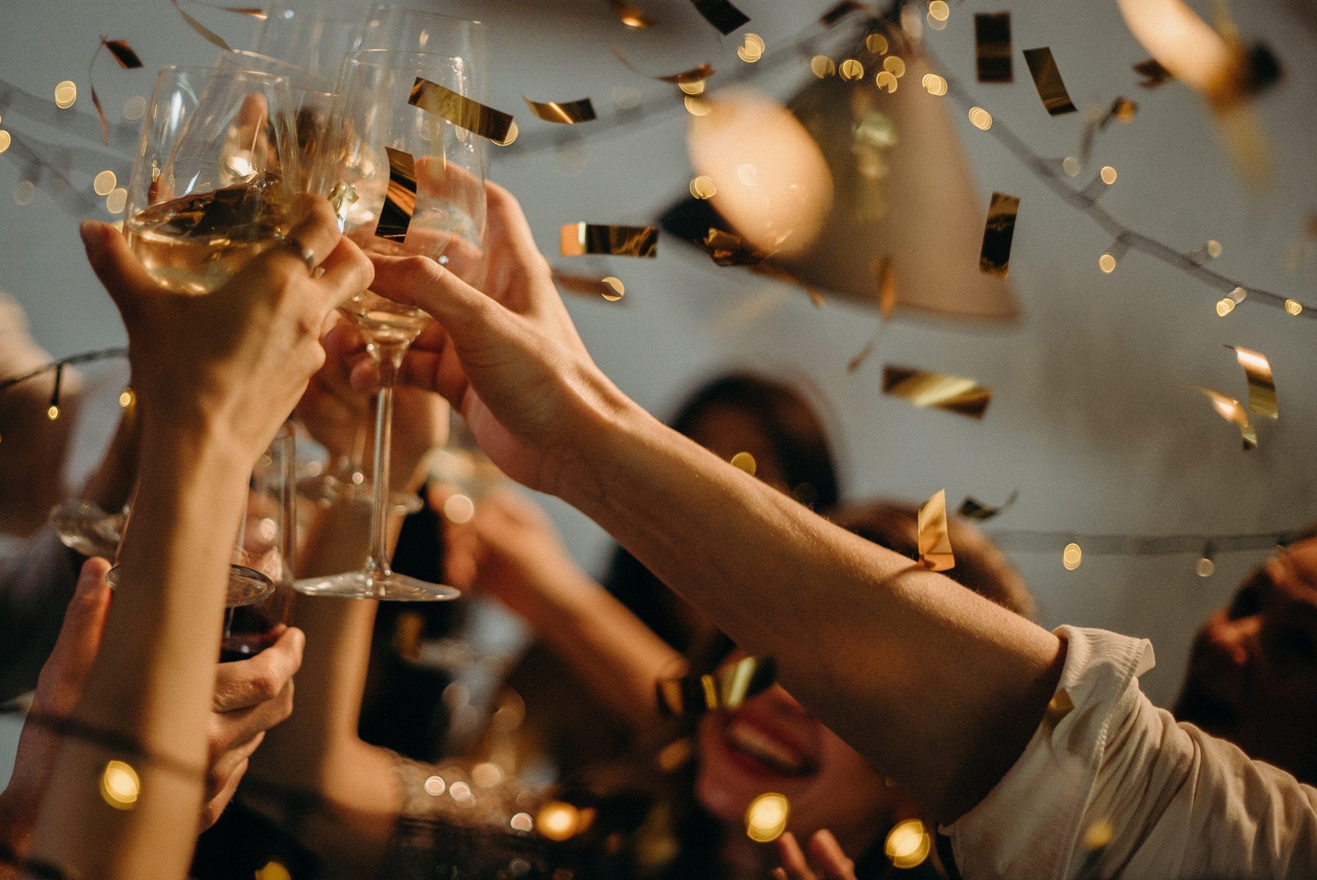 People toasting wine